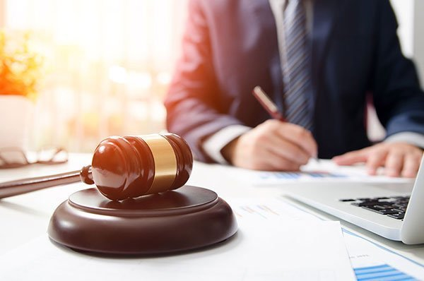 Attorney working on probate and trust administration for a client